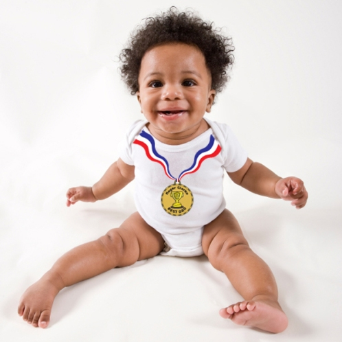 Happy African American baby sitting up, white background